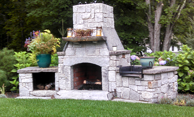 Custom stone fireplace in Bedford NH by CR Hardscapes