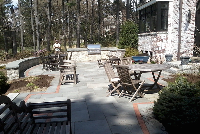 Stone patio and free standing stone sitting wall in Bedford New Hampshire