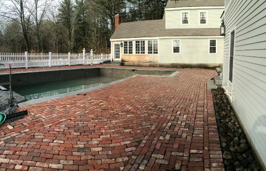 Clay Brick Patio Around A Pool In New Boston, NH By CR Hardscapes