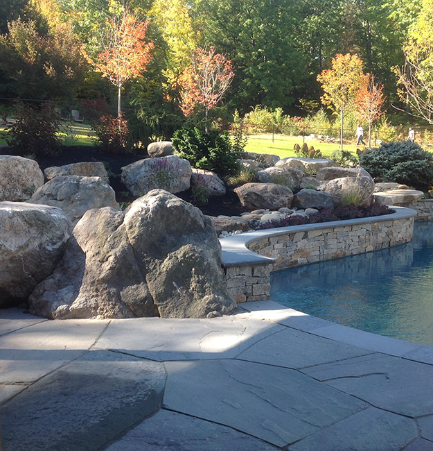 Natural stone around a swimming pool in Bow NH