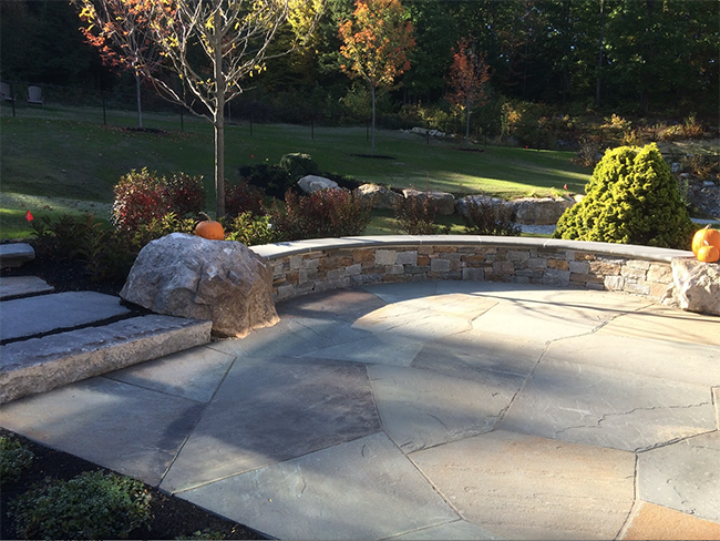 Stone patio with sitting wall near Concord New Hampshire