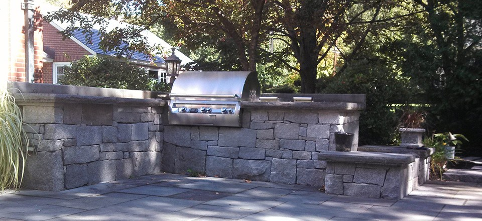 Landscape design with outdoor kitchen design in Bedford New Hampshire.