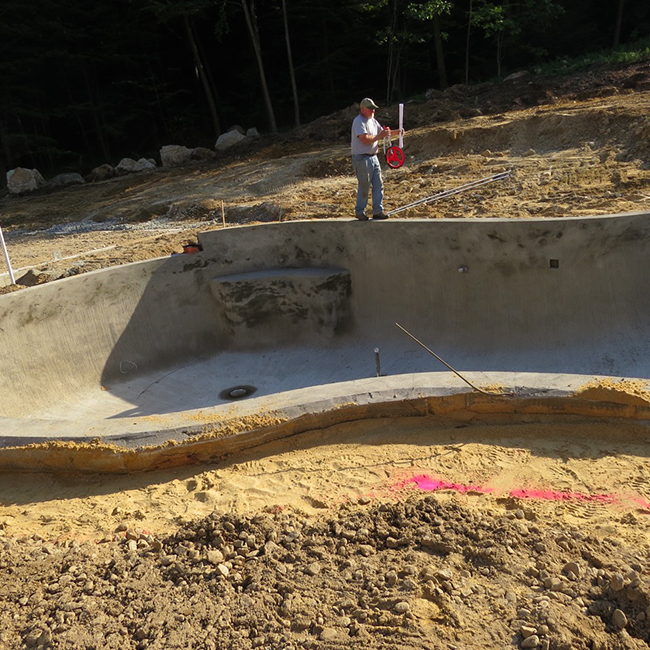Swimming Pool Installation in Bow New Hampshire is part of of a master landscape plan by CR Hardscapes