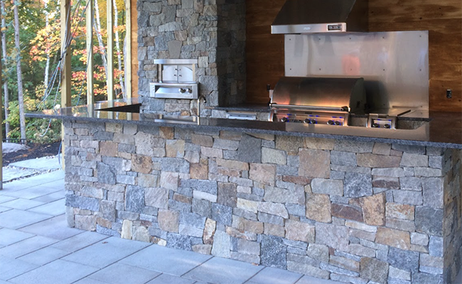 Outdoor kitchen design with pizza oven in Bow NH