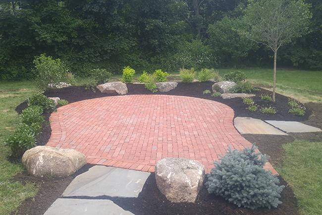 Brick patio in Hopkinton New Hampshire by landscape company CR Hardscapes